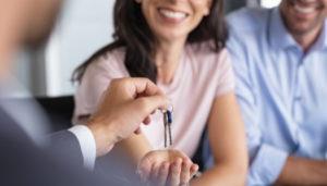Real Estate Agent handing keys